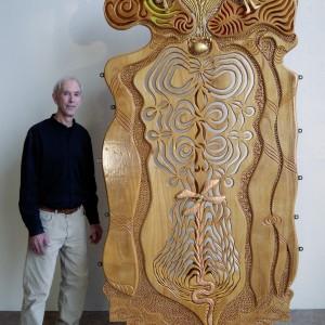 Marcel Dubub,  Quinconce.  Panneau de bois marin okoumé, verre teinté, feuilles de métal.  8' x 4' x 1''1/2.  Photo avec l'aimable autorisation de l'artiste.
